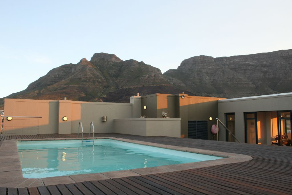13 Rooftop pool with mountain views evening